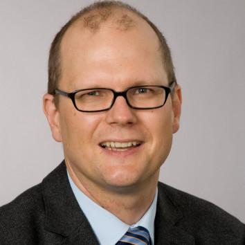 Oliver Tüscher
